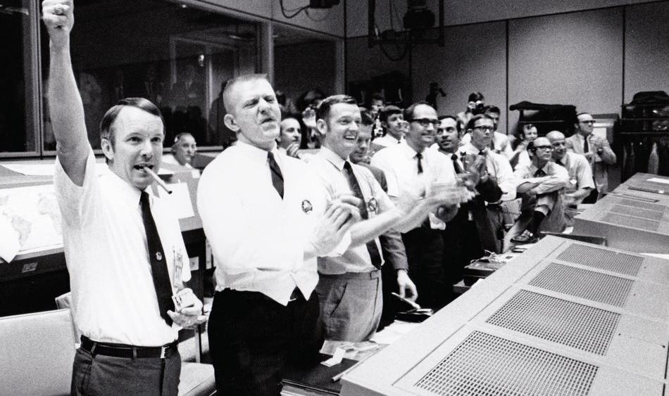 From left to right: Chris Kraft, Gene Kranz, Glynn Lunney, Gerry Griffin, John Aaron, Ed Fendell, Jerry Bostick, Jim Lovell, Gene Cernan, Charlie Duke, Steve Bales.